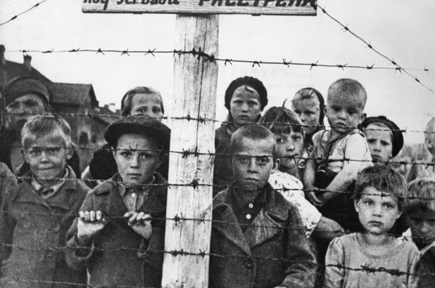 Children in a World War II concentration camp, circa 1943 / Getty Images