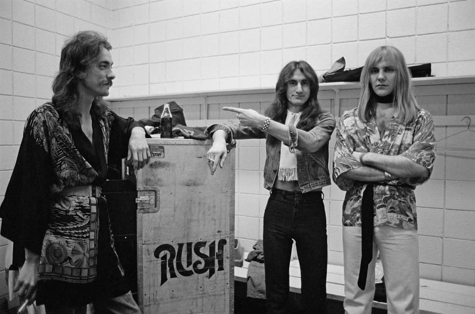 Peart, Lee and Lifeson on tour early in their career