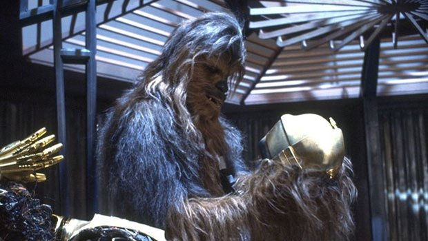 Chewie pieces Threepio back together again - Photo: Lucasfilm/Disney